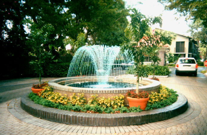Circle Drive Fountain We installed the plant bed, planted all the plants surrounding the circle drive, as well as the trees shown and the hedges around the drive.